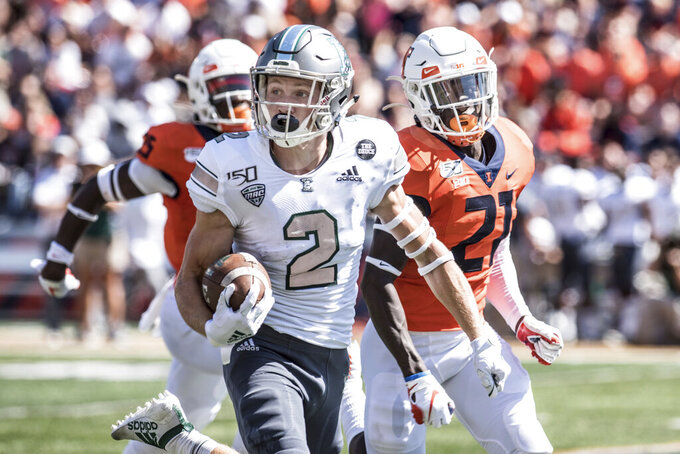 Eastern Michigan's Matthew Sexton (2) heads to the end zone pursued by Illinois's Jartavius Martin (21) in the first half of a NCAA college football game between Illinois and Eastern Michigan, Saturday, Sept.14, 2019, in Champaign, Ill. (AP Photo/Holly Hart)