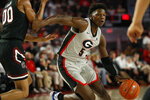 Georgia's Anthony Edwards (5) is defended by South Carolina's AJ Lawson during an NCAA college basketball game Wednesday, Feb. 12, 2020, in Athens, Ga. (Joshua L. Jones/Athens Banner-Herald via AP)