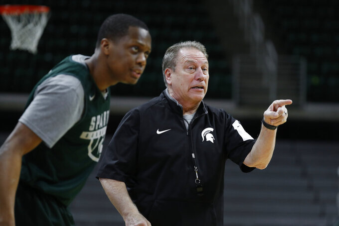 Michigan State head basketball coach Tom Izzo, right, gives instructions during practice in East Lansing, Mich., Monday, Feb. 18, 2019. Izzo and Michigan coach John Beilein are friendly rivals, whose highly ranked NCAA college basketball teams will play for the first time this season on Sunday at Crisler Arena. As much as Beilein and Izzo genuinely like and respect each other, the highly competitive coaches want to win. (AP Photo/Paul Sancya)