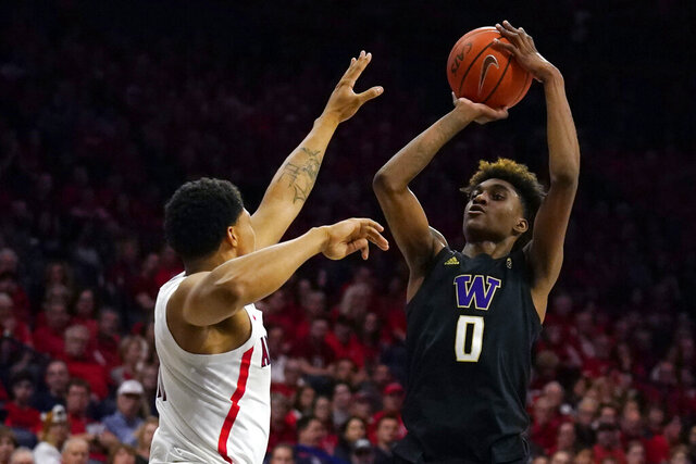 FILE - In this March 7, 2020, file photo, Washington forward Jaden McDaniels shoots during the first half of the team's NCAA college basketball game against Arizona in Tucson, Ariz. McDaniels was selected by the Los Angeles Lakers in the NBA draft Wednesday, Nov. 18, 2020.(AP Photo/Rick Scuteri, File)