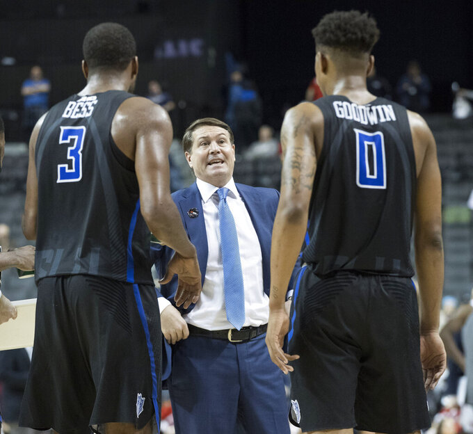Saint Louis head coach Travis Ford gives guard Javon Bess (3) and guard Jordan Goodwin (0) instruction during a time out in the second half of an NCAA college basketball game against Dayton in the Atlantic 10 Conference tournament, Friday, March 15, 2019, in New York. Saint Louis won 64-55. ( (AP Photo/Mary Altaffer)