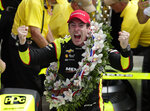 Simon Pagenaud, of France, celebrates after winning the Indianapolis 500 IndyCar auto race at Indianapolis Motor Speedway, Sunday, May 26, 2019, in Indianapolis. (AP Photo/Michael Conroy)
