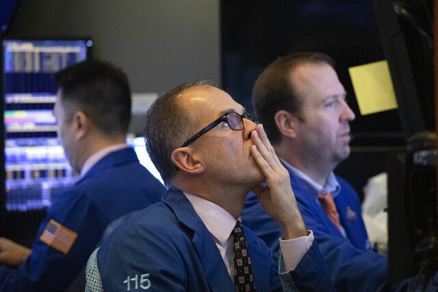 FILE - In this Jan. 2, 2020, file photo traders monitor stock prices at the New York Stock Exchange. Over the next few weeks, companies across the country will be telling investors how much profit they made in the last three months of 2019. (AP Photo/Mark Lennihan, File)