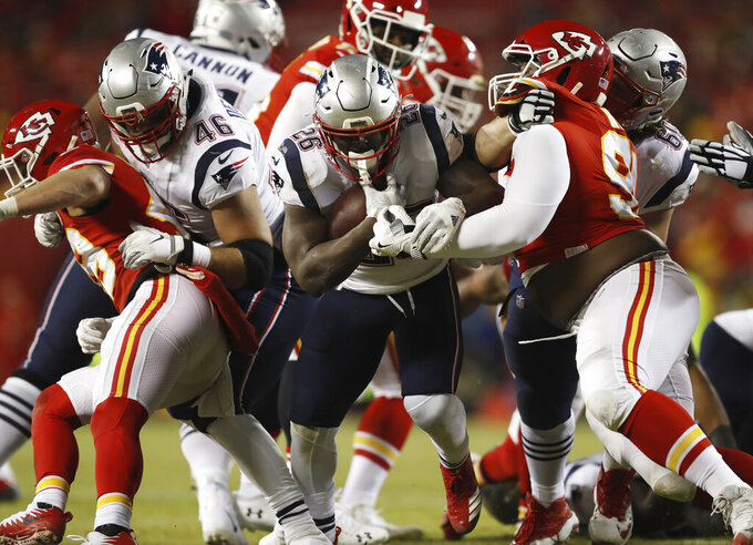 New England Patriots running back Sony Michel (26) runs against Kansas City Chiefs defense during the first half of the AFC Championship NFL football game, Sunday, Jan. 20, 2019, in Kansas City, Mo. (AP Photo/Jeff Roberson)