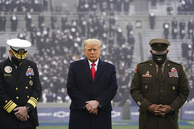 FILE - In this Dec. 12, 2020, file photo President Donald Trump stands on the field before the 121st Army-Navy Football Game in Michie Stadium at the United States Military Academy in West Point, N.Y. Trump himself largely keeps to the Oval Office, still fighting the Election Day results and offering scant acknowledgement of the pain and suffering the nation is facing in the darkest hours of the COVID-19 pandemic. (AP Photo/Andrew Harnik, File)
