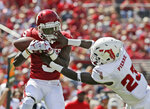 Oklahoma wide receiver Marquise Brown (5) catches a pass defended by Florida Atlantic safety James Pierre (23) in the first half of an NCAA college football game in Norman, Okla., Saturday, Sept. 1, 2018. (AP Photo/Sue Ogrocki)