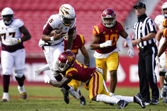 Arizona State quarterback Jayden Daniels (5) is tackled by Southern California safety Greg Johnson (9) during the second half of an NCAA college football game Saturday, Nov. 7, 2020, in Los Angeles. (AP Photo/Ashley Landis)