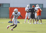 Miami Hurricanes defensive back Te'Cory Couch runs drills during practice at the University of Miami Greentree Practice Field in Coral Gables on Thursday, August 8, 2019.(David Santiago/Miami Herald via AP)