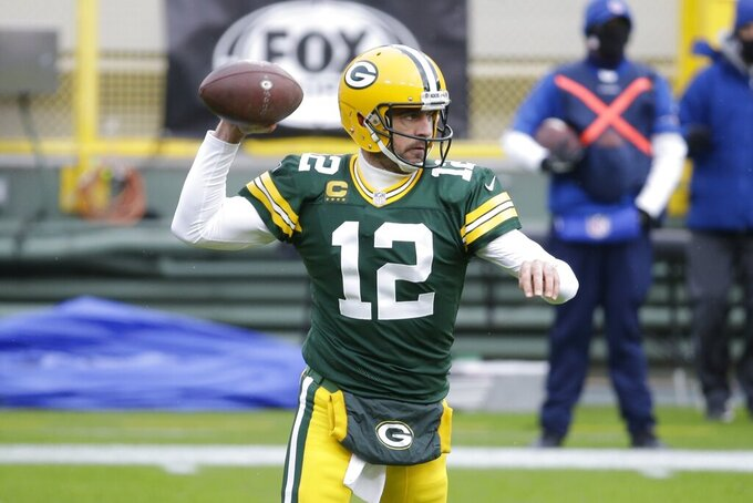 Green Bay Packers' Aaron Rodgers throws during the first half of an NFL football game against the Minnesota Vikings Sunday, Nov. 1, 2020, in Green Bay, Wis. (AP Photo/Mike Roemer)