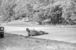 FILE - In this June 6, 1966, file photo, civil rights activist James Meredith grimaces in pain as he pulls himself across Highway 51 after being shot in Hernando, Miss., during his Walk Against Fear.
