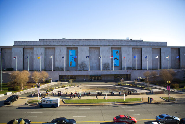 FILE - In this April 3, 2019, file photo people visit the Smithsonian Museum of American History on the National Mall at 14th Street and Constitution Ave., in Washington. In response to rising COVID-19 infection numbers, the Smithsonian Institution is indefinitely shutting down operations at all its facilities, effective Monday and affecting seven museums, plus the National Zoo. (AP Photo/Pablo Martinez Monsivais, File)