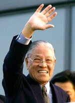 FILE - In this April 22, 2001, file photo, former Taiwanese President Lee Teng-hui waves to well-wishers upon his arrival at Kansai International Airport in western Japan. Local media are reporting that ex-Taiwanese President Lee Teng-hui, who oversaw the island's transition to full democracy, has died. Lee was 97 and had largely dropped out of public life in his later years (AP Photo/Katsumi Kasahara)