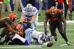 Dallas Cowboys running back Ezekiel Elliott, bottom center, fumbles the ball as Cleveland Browns' Andrew Sendejo (23), Vincent Taylor (96) and others race after the loose ball in the first half of an NFL football game in Arlington, Texas, Sunday, Oct. 4, 2020. The Browns recovered the ball. (AP Photo/Ron Jenkins)