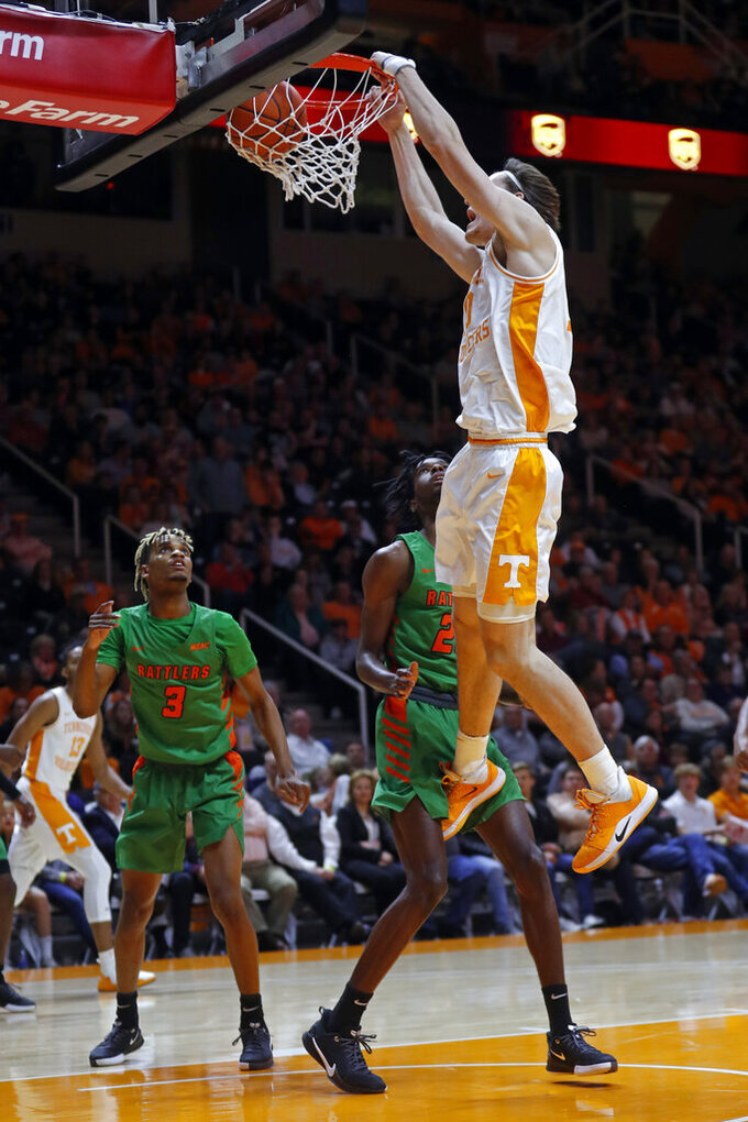 Tennessee forward John Fulkerson (10) dunks the ball over Florida A&M forward DJ Jones (25) during the first half of an NCAA college basketball game Wednesday, Dec. 4, 2019, in Knoxville, Tenn. (AP Photo/Wade Payne)