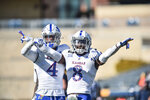 Kansas cornerback Kyle Mayberry (8) reacts after breaking up a pass against West Virginia during an NCAA college football game, Saturday, Oct. 17, 2020, in Morgantown, W.Va. (William Wotring/The Dominion-Post via AP)