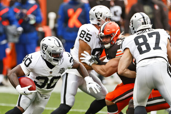 Las Vegas Raiders running back Jalen Richard (30) returns the opening kickoff during the first quarter of an NFL football game against the Cleveland Browns, Sunday, Nov. 1, 2020, in Cleveland. (AP Photo/Ron Schwane)