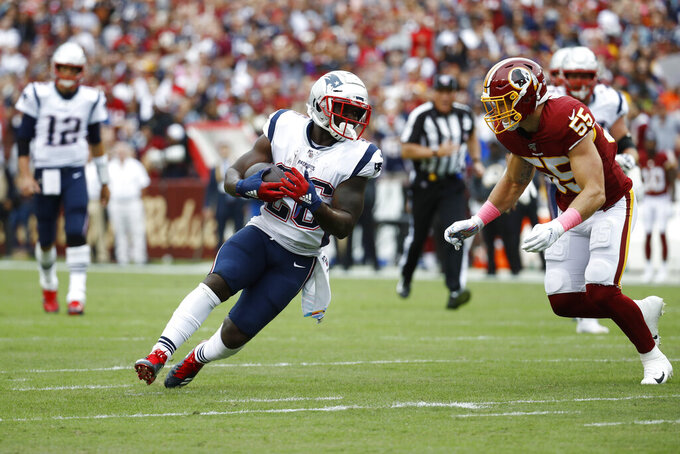 New England Patriots running back Sony Michel (26) runs against Washington Redskins linebacker Cole Holcomb (55) during the first half of an NFL football game, Sunday, Oct. 6, 2019, in Washington. (AP Photo/Patrick Semansky)