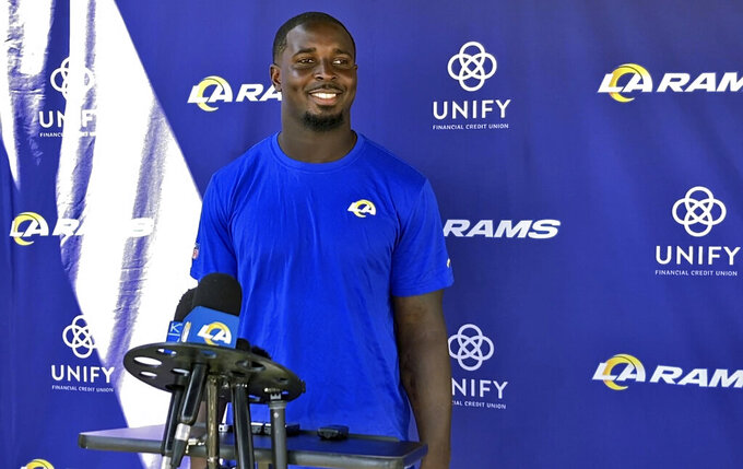 In this image taken video, Los Angeles Rams running back Sony Michel speaks with reporters at the NFL football team's training complex in Thousand Oaks, Calif., Thursday, Aug. 26, 2021. Michel watched his first practice with his new team after the Rams acquired the former Super Bowl star from the New England Patriots earlier in the week. (AP Photo/Greg Beacham)