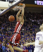 Washington State's CJ Elleby, left, dunks in front of Washington's Sam Timmins during the first half of an NCAA college basketball game Friday, Feb. 28, 2020, in Seattle. (AP Photo/Elaine Thompson)