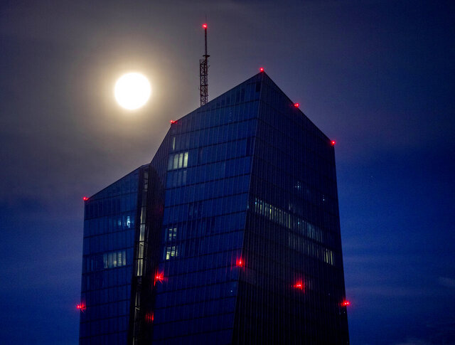 File - In this Thursday, Sept. 3 2020 file picture the moon shines over the European Central Bank in Frankfurt, Germany. Low inflation, in negative territory for the first time since 2016, is leading analysts to think the ECB will have to add more stimulus to support what could be a drawn-out, difficult recovery from the virus outbreak in the 19 countries that use the euro. (AP Photo/Michael Probst, File)