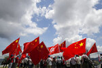 Pro-China supporters hold Chinese and Hong Kong national flags during a rally to celebrate the approval of a national security law for Hong Kong, in Hong Kong, Tuesday, June 30, 2020. Hong Kong media are reporting that China has approved a contentious law that would allow authorities to crack down on subversive and secessionist activity in Hong Kong, sparking fears that it would be used to curb opposition voices in the semi-autonomous territory. (AP Photo/Kin Cheung)
