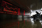A Chinese investor monitors stock prices at a brokerage house in Beijing, Wednesday, Oct. 23, 2019. Asian stock markets followed Wall Street lower Wednesday after major companies reported mixed earnings and an EU leader said he would recommend the trade bloc allow Britain to delay its departure. (AP Photo/Andy Wong)