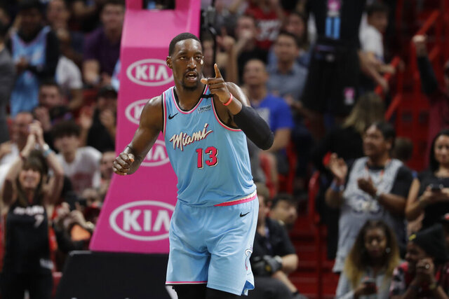 Miami Heat forward Bam Adebayo celebrates after scoring during the second half of an NBA basketball game against the Milwaukee Bucks, Monday, March 2, 2020, in Miami. (AP Photo/Wilfredo Lee)