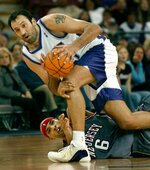 FILE - In this Nov. 30, 2003, file photo, Sacramento Kings center Vlade Divac, top, fights to keep his balance after New Jersey Nets forward Kenyon Marton tried to steal the ball during the second half of an NBA basketball game in Sacramento, Calif. NBA stars Vlade Divac, Sidney Moncrief and Jack Sikma are the headliners of the 2019 class for the Basketball Hall of Fame. The honorees were announced Saturday, April 6, 2019, in Minneapolis before the Final Four.  (AP Photo/Steve Yeater, File)