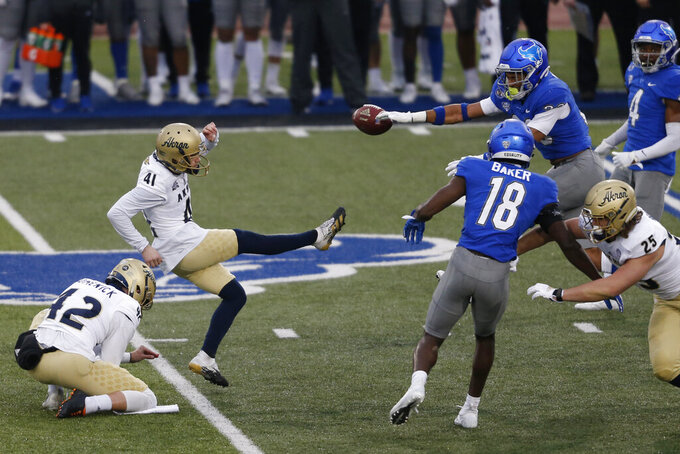 Buffalo's Tyrone Hill (33) blocks a field goal by Akron kicker Cory Smigel (41) during the first half of an NCAA college football game in Amherst, N.Y., Saturday, Dec. 12, 2020. (AP Photo/Jeffrey T. Barnes)