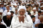 Pakistani faithful offer Eid al-Fitr prayers to celebrate the end of the holy month of Ramadan in Peshawar, Pakistan, Friday, June 15, 2018. Eid al-Fitr is being celebrated in parts of Khyber-Pakhtunkhwa province on Friday while rest of Pakistan will begin the festivities on Saturday. (AP Photo/Muhammad Sajjad)