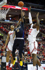 Purdue Fort Wayne guard Deonte Billups (15) goes up for shot between Ohio State guard D.J. Carton, left, and forward E.J. Liddell during the first half of an NCAA college basketball game in Columbus, Ohio, Friday, Nov. 22, 2019. (AP Photo/Paul Vernon)