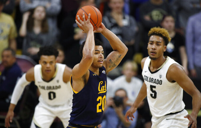 California guard Matt Bradley, front, looks to pass the ball as Colorado guards Shane Gatling, back left, and D'Shawn Schwartz defend in the second half of an NCAA college basketball game Thursday, Feb. 6, 2020, in Boulder, Colo. (AP Photo/David Zalubowski)
