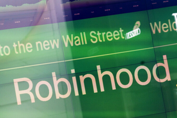 An electronic screen at Nasdaq displays Robinhood in New York's Times Square following the company's IPO, Thursday, July 29, 2021. Robinhood is selling its own stock on Wall Street, the very place the online brokerage has rattled with its stated goal of democratizing finance. Through its app, Robinhood has introduced millions to investing and reshaped the brokerage industry, all while racking up a long list of controversies in less than eight years. (AP Photo/Mark Lennihan)