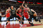 Boston Celtics forward Gordon Hayward, right, drives to the basket against the Chicago Bulls during the second half of an NBA basketball game in Chicago, Saturday, Jan. 4, 2020. The Celtics won 111-104. (AP Photo/Nam Y. Huh)
