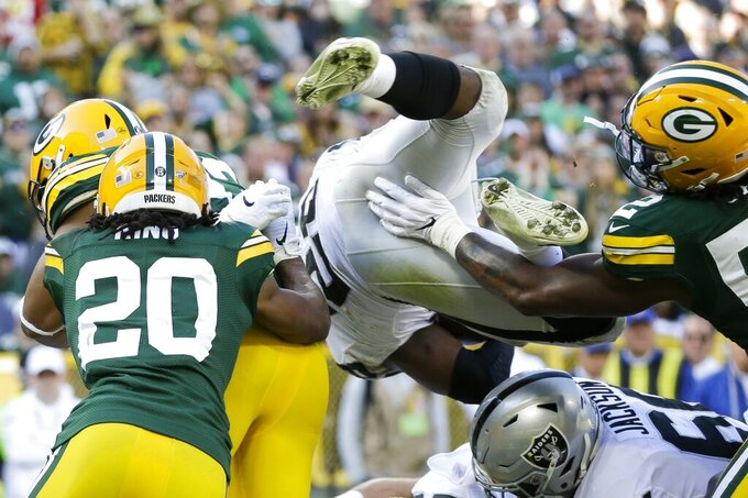 Oakland Raiders' Josh Jacobs is stopped at the goal line on a fourth down play during the second half of an NFL football game against the Green Bay Packers Sunday, Oct. 20, 2019, in Green Bay, Wis. (AP Photo/Jeffrey Phelps)