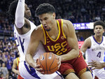 FILE - In this Jan. 30, 2019, file photo, Southern California's Bennie Boatwright (25) tries to muscle past Washington's Noah Dickerson during the first half of an NCAA college basketball game, in Seattle. Boatwright was named to the AP All-Pac-12 team, Tuesday, March 12, 2019. (AP Photo/Elaine Thompson, File)