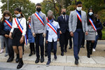 Young representatives of the municipal council attend ceremony with French President Emmanuel Macron in Les Mureaux, northwest of Paris, Friday, Oct. 2, 2020. President Emmanuel Macron, trying to rid France of what authorities say is a