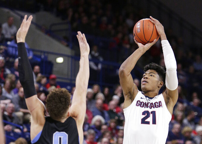 Gonzaga forward Rui Hachimura (21) shoots over San Diego forward Isaiah Pineiro during the second half of an NCAA college basketball game in Spokane, Wash., Saturday, Feb. 2, 2019. (AP Photo/Young Kwak)