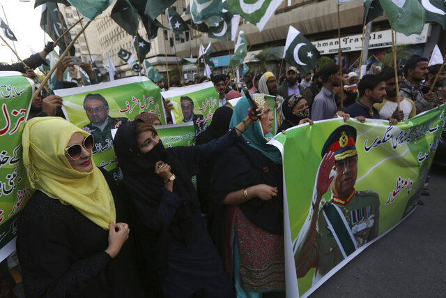 Supporters of former Pakistani military ruler Gen. Pervez Musharraf protest a court's decision, in Karachi, Pakistan, Wednesday, Dec. 18, 2019. The Pakistani court sentenced Musharraf to death in a treason case related to the state of emergency he imposed in 2007 while in power, officials said. Musharraf who is apparently sick and receiving treatment in Dubai where he lives was not present in the courtroom. (AP Photo/Fareed Khan)