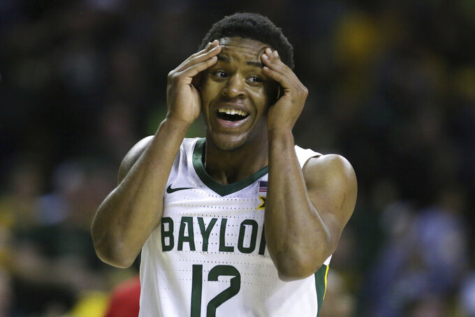 Baylor guard Jared Butler reacts to a score against West Virginia in the first half of an NCAA college basketball game, Saturday, Feb. 15, 2020, in Waco, Texas. (AP Photo/Rod Aydelotte)