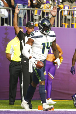 Seattle Seahawks wide receiver DK Metcalf (14) celebrates after a touchdown in the first half of an NFL football game against the Minnesota Vikings in Minneapolis, Sunday, Sept. 26, 2021. (AP Photo/Bruce Kluckhohn)