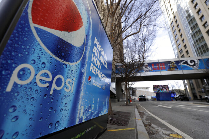 FILE - In this Jan. 30, 2019, file photo, an advertisement for Pepsi is shown downtown for the NFL Super Bowl 53 football game in Atlanta.  PepsiCo is joining forces with Beyond Meat to develop new snacks and drinks made from plant-based proteins. The companies aren't yet saying what kinds of products they will make.  (AP Photo/David J. Phillip, File)