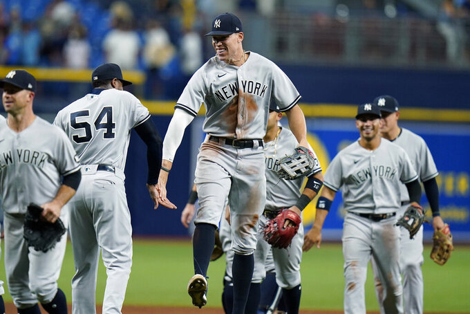 New York Yankees' Aaron Judge, center, celebrates with relief pitcher Aroldis Chapman, second from left, after the team defeated the Tampa Bay Rays during a baseball game Wednesday, July 28, 2021, in St. Petersburg, Fla. (AP Photo/Chris O'Meara)