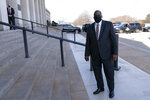 Defense Secretary Lloyd Austin arrives at the Pentagon, Friday, Jan. 22, 2021, in Washington. (AP Photo/Alex Brandon)