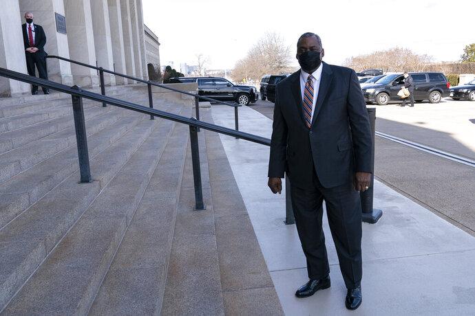 Defense Secretary Lloyd Austin arrives at the Pentagon, Friday, Jan. 22, 2021, in Washington. (AP Photo/Alex Brandon)
