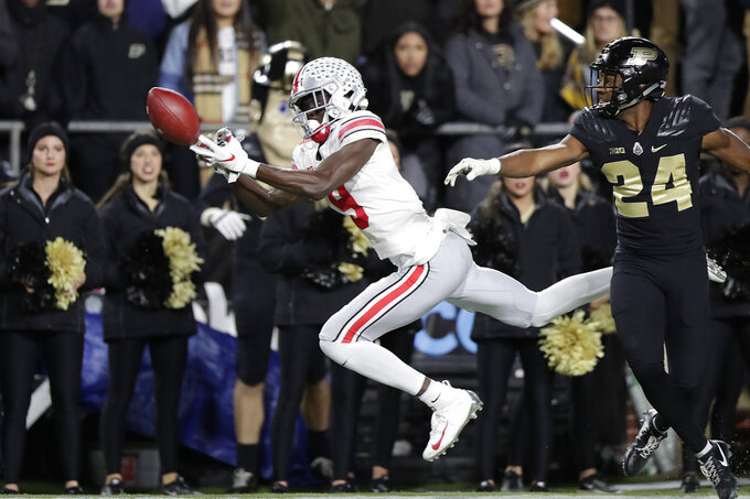 Ohio State wide receiver Binjimen Victor (9) drops a catch in front of Purdue cornerback Tim Cason (24) during the second half of an NCAA college football game in West Lafayette, Ind., Saturday, Oct. 20, 2018. (AP Photo/Michael Conroy)