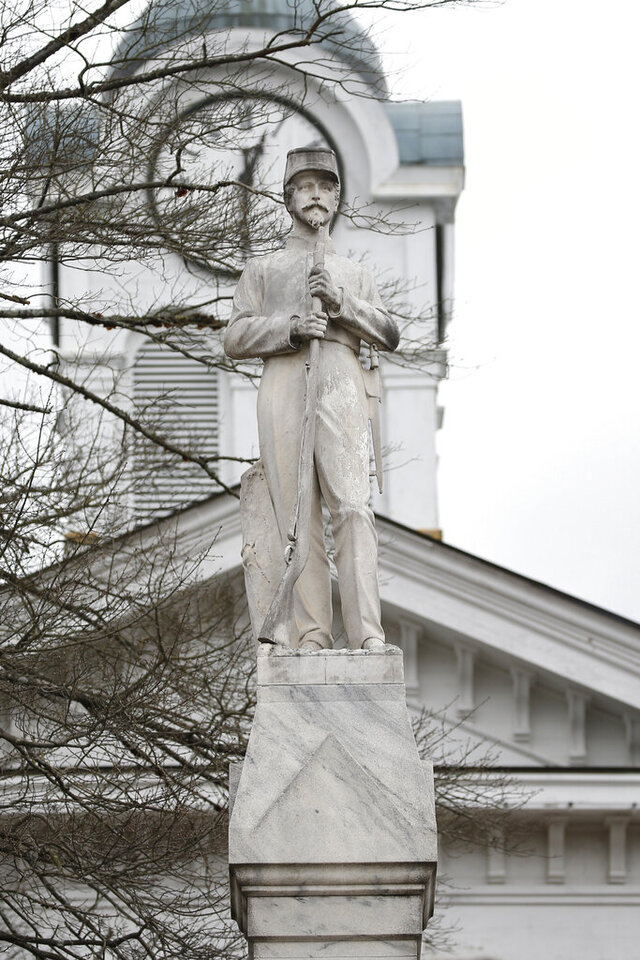FILE - The Confederate soldier's monument overlooks the old county courthouse on the town square in Oxford, Miss., Feb. 23, 2019. The monument has been there since 1907. However, protests against racial injustice across the nation in the past three months have brought renewed debate about the display and or possible relocation of the Confederate monument. (AP Photo/Rogelio V. Solis)