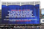 A sign over center field explains to fans that a scheduled baseball game between the New York Yankees and the Tampa Bay Rays has been postponed as the first game of a single admission doubleheader for Thursday, on Wednesday, July 17, 2019, at Yankee Stadium in New York. (AP Photo/Kathy Willens)