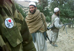 FILE - In this Dec. 14, 2001 file photo,  an Afghan anti-Taliban fighter, wearing an
