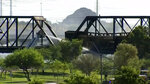 Smoke fills the sky at the scene of a train derailment in Tempe, Ariz., on Wednesday, July 29, 2020. Officials say a freight train traveling on a bridge that spans a lake in the Phoenix suburb derailed and set the bridge ablaze and partially collapsing the structure.  There were no immediate reports of any leaks. (AP Photo/Pool)